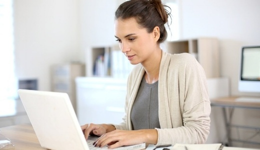 Attractive woman working in office on laptop-535731-edited