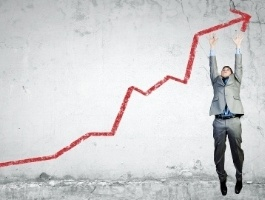 Image of young businessman jumping above graph-372647-edited-075277-edited